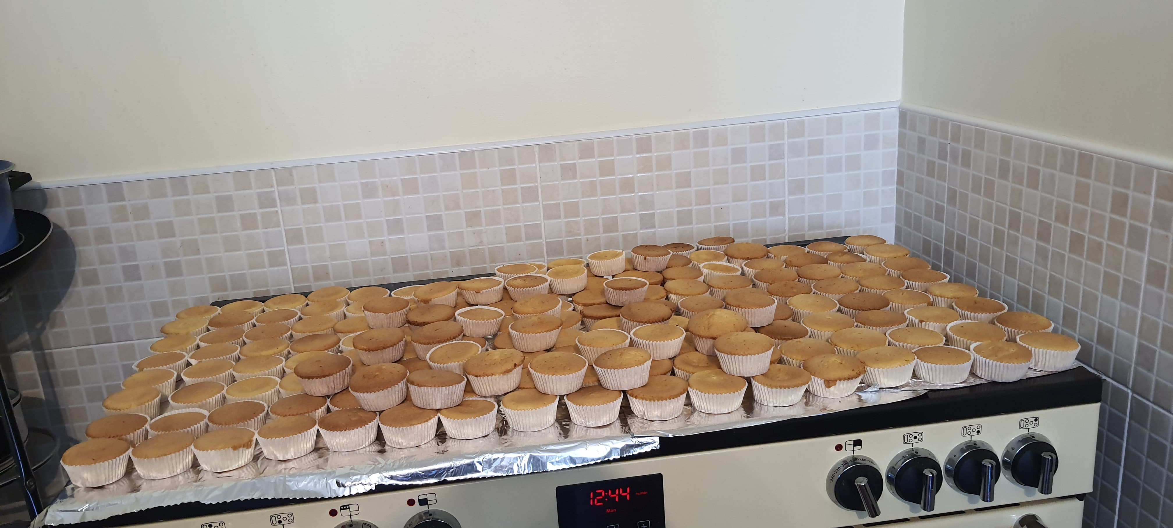 Joan's cake baking for her friends V.E afternoon tea boxes. 300 made in total!